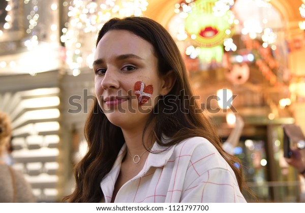 Moscow, Russia - June 26, 2018: Danish girl football fan on the night streets of Moscow. Soccer fans from abroad walking down the Nikolskaya streets, FIFA world cup, Mundial 2018