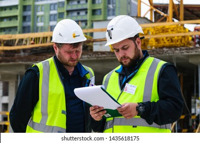 Moscow, Russia - June 26 2019: A group of surveyors is measuring on the construction site of a residential building in West Degunino district in Moscow.