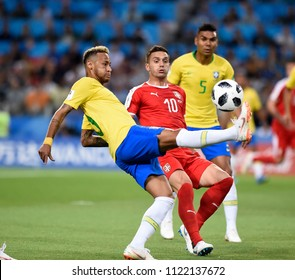 MOSCOW, RUSSIA - June 27, 2018: Neymar  of Brazil andDusan Tadic  of Serbia compete for the ball during the World Cup Group E football match between Brazil and Serbia at Spartak Stadium.