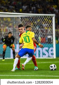Moscow, Russia - June 27, 2018. Brazilian superstar Neymar against Serbia midfielder Nikola Milenkovic during FIFA World Cup 2018 match Serbia vs Brazil.