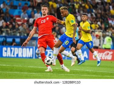 Moscow, Russia - June 27, 2018. Brazilian superstar Neymar against Serbia national team midfielder Sergej Milinkovic-Savic during FIFA World Cup 2018 match Serbia vs Brazil.
