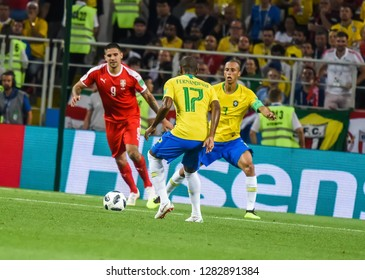 Moscow, Russia - June 27, 2018. Brazil defender Fernandinho with defender Miranda and Serbia striker Aleksandar Mitrovic in the background, during FIFA World Cup 2018 match Serbia vs Brazil.
