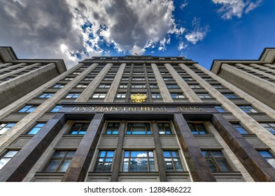 """Moscow, Russia - June 27, 2018: Building of The State Duma of Russian Federation in Moscow, Russia. The State Duma was first introduced in 1906. Russian inscription saying """"State Duma""""."""
