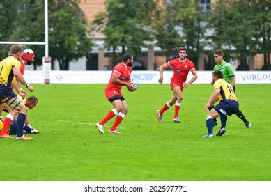 MOSCOW, RUSSIA - JUNE 28, 2014: Rugby match Georgia (red uniform) vs Romania during the FIRA-AER European Grand Prix Series. Georgia won 38-0
