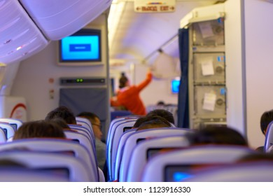 MOSCOW, RUSSIA - JUNE 28, 2018: Passengers await take off in an Aeroflot plane. Moscow - Hong Kong route.