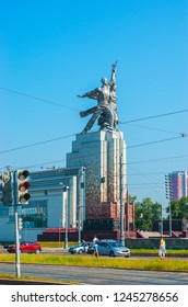 MOSCOW, RUSSIA - JUNE 29, 2013: Observe the statue of Worker and Kolkhoz Woman, created of steel and located in Mira Prospect, on June 29 in Moscow.
