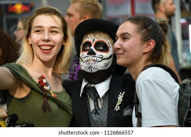 Moscow, Russia - June 29, 2018: Smailing girls make a selfie with participant in makeup during Dia de los Muertos Mexican carnival. Sugar skull makeup. Day of The Dead