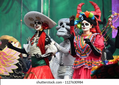Moscow, Russia - June 29, 2018: Participants in traditional clothing during Dia de los Muertos Mexican carnival. Sugar skull makeup. Day of The Dead