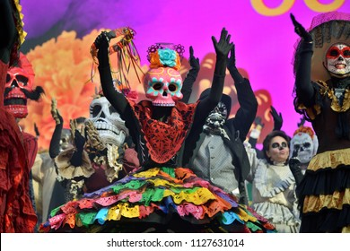 Moscow, Russia - June 29, 2018: Participants in traditional clothing during Dia de los Muertos Mexican carnival. Sugar skull makeup. Day of The Dead parade