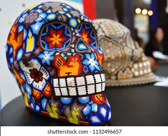 Moscow, Russia - June 29, 2018: Colourful skull from mexican traditional huichol bead art symbol of the day of the dead. Souvenir at market on Dia de los Muertos - Day of The Dead