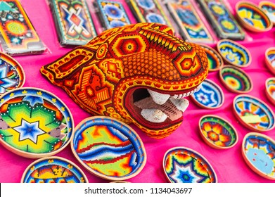 MOSCOW, RUSSIA - June 29, 2018: The 2018 FIFA World Cup. A National house for Mexican fans in Gostiny Dvor. National Souvenirs crafts of the Huichol mosaic of beads