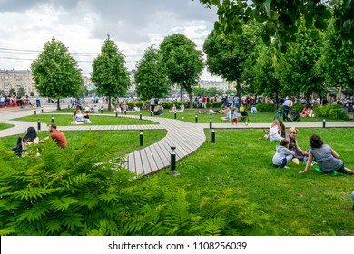 MOSCOW, RUSSIA - JUNE 3, 2018: People having rest on the grass in Gorky Park.