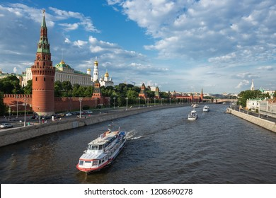 MOSCOW, RUSSIA - JUNE 3, 2018: View of the river Moscow with walking ship, Kremlevskaya Embankment and towers of the Kremlin