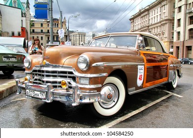 MOSCOW, RUSSIA - JUNE 3: American motor car Chrysler Town & Country competes at the annual L.U.C. Chopard Classic Weekend Rally on June 3, 2012 in Moscow, Russia.