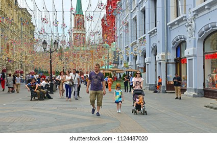 MOSCOW, RUSSIA - JUNE 30, 2018: 2018 FIFA World Cup. Tourists on Nikolskaya street in center of Moscow