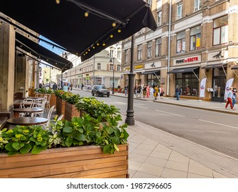 Moscow, Russia, June 4, 2021. Myasnitskaya street,  fragment of the architectural ensemble. Cozy cafe in the foreground