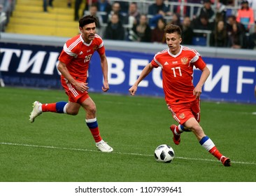Moscow, Russia - June 5, 2018. Russian left back Yury Zhirkov and midfielder Alexander Golovin against Turkish defender Sener Ozbayrakli during international friendly Russia vs Turkey.
