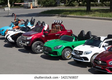Moscow, RUSSIA - June 5, 2019 Multi-colored children's cars in the form of jeeps in a rental in the park