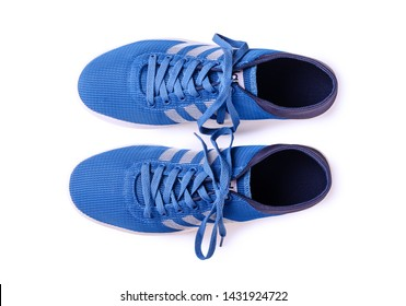 MOSCOW, RUSSIA - June 5, 2019: Adidas sneakers for running, football, training and skateboarding in white and blue, showing the Adidas logo and famous three stripes, top view illustrative editorial