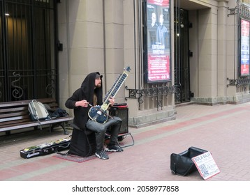 Moscow, Russia, June 5, 2021: A street musician plays bola baja  Sitar. Moscow.