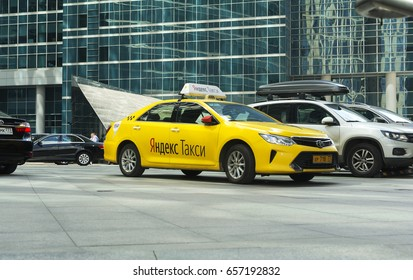 Moscow, Russia - June 8, 2017. Yandex taxi next to the business center Moscow-city. common taxi in Russia for the quality and pricing