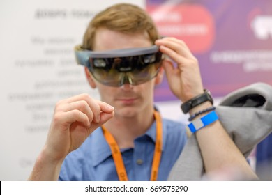 Moscow, Russia - June 8, 2017: Young man testing hololens VR glasses at VR conference
