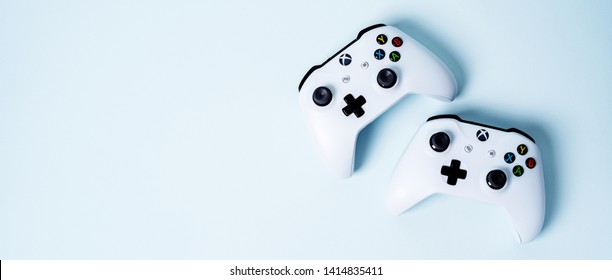 Moscow, Russia - Juney 03 2019: white Wireless Gamepads Xbox One S controller joystick on blue pastel background with copy space. Creative Minimal Gaming concept.