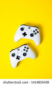 Moscow, Russia - Juney 03 2019: white two Wireless Gamepads Xbox One S controller joystick on yellow background with copy space. Creative Minimal Gaming concept.