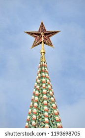MOSCOW, RUSSIA - Kremlin Ruby Star on the Top of Spasskaya Tower. View from the Red Square on the top of Spasskaya (Savior's) Tower of Moscow Kremlin decorated with pentagonal star made of ruby glass.