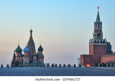 MOSCOW, RUSSIA - The main attractions of Moscow city, St. Basil's Cathedral and Spasskaya (Savior) Tower of Moscow Kremlin at the empty Red Square at sunrise