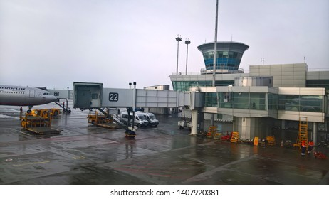 Moscow, Russia - Mar 2019: Sheremetyevo International Airport, Jet bridge or jetway bridge on prepare by ground Service crew for passenger depart or arrived.