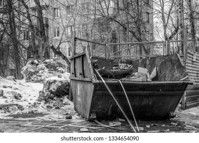MOSCOW, RUSSIA - MARCH 02,2019:  Crowded trash containers. The problem of waste disposal is particularly relevant in large cities.