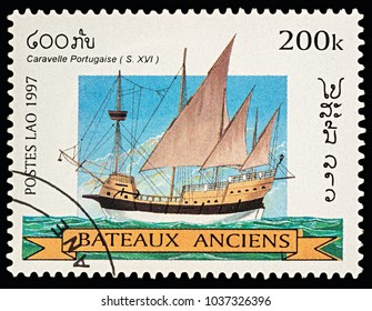 "Moscow, Russia - March 03, 2018: A stamp printed in Laos shows ancient Portuguese caravel (16th-century), series ""Sailing Ships"", circa 1997"