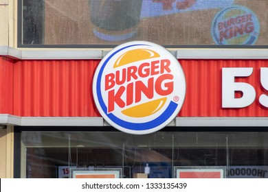 MOSCOW, RUSSIA - MARCH 07, 2019: Burger king restaurants logo on the fasade, global chain of hamburger fast food restaurants.