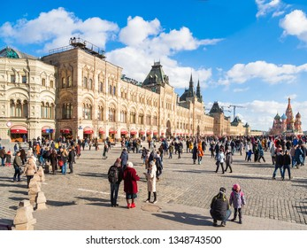 MOSCOW, RUSSIA - March 09, 2019. People walking on Red Square near famous St. Basil's Cathedral and Main Department Store (GUM).