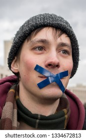 Moscow, RUSSIA - March 10, 2019: Sakharov Prospect. Political rally for free Internet. Youth with political posters. The boy with his mouth taped