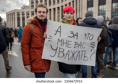 Moscow, RUSSIA - March 10, 2019: Sakharov Prospect. Political rally for free Internet. Youth with political posters: Why should I respect you?