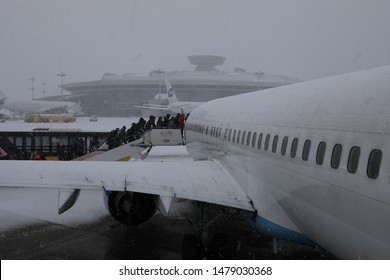 MOSCOW, RUSSIA - MARCH 10, 2019: Boarding people on the ladder