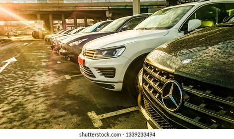 MOSCOW, RUSSIA - MARCH 12, 2019: luxury Cars For Sale Stock Lot Row. Car Dealer Inventory. Cars For Sale Stock Lot Row. Car Dealer Inventory. sunset sun rays light. sun beam