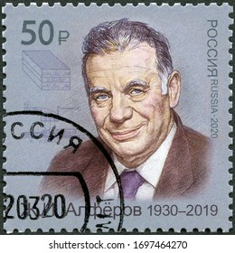MOSCOW, RUSSIA - MARCH 12, 2020: A stamp printed in Russia shows Zhorez Ivanovich Alferov (1930-2019), Soviet physicist, Noble Prize Winners series, 2020