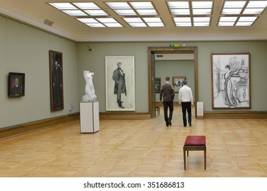 MOSCOW, RUSSIA - MARCH 13, 2015: State Tretyakov Gallery is art gallery, foremost depository of Russian fine art in world.Gallery's history starts in 1856. Tourists in hall of artist Serov V.