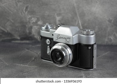 MOSCOW, RUSSIA, MARCH 13, 2019. The old Soviet 35 mm SLR camera Zenit 3M, released 1968 on black cement background.