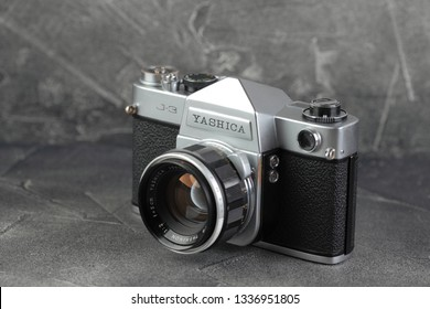 MOSCOW, RUSSIA, MARCH 13, 2019. The old Japan 35 mm SLR camera Yashica J-3, released 1962 on grey cement background.
