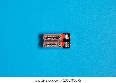 Moscow, Russia - March 13, 2019:  Energizer battery on blue background. Energizer Holdings, Inc. is an American manufacturer and one of the world's largest manufacturers of batteries