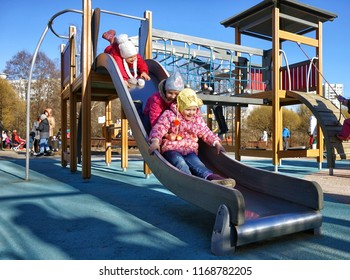 MOSCOW, RUSSIA - March 15, 2015: Children ride from the hill on the playground. New playgrounds, the program of renovation of public areas in Moscow.