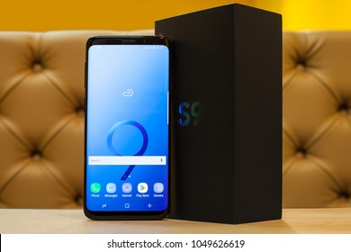 Moscow, Russia - March 15, 2018: Smartphone Samsung Galaxy S9 black in interior.