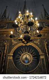 MOSCOW, RUSSIA - March 15, 2020 Illuminated chandelier and fragment of a central part of iconostasis of the Chapel of the Entry of Our Lord into Jerusalem (western Chapel of St. Basil's Cathedral)