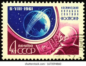 Moscow, Russia - March 16, 2020: stamp printed in USSR (Russia) shows spaceship Vostok-2 with second soviet cosmonaut German Titov (1935-2000), circa 1961