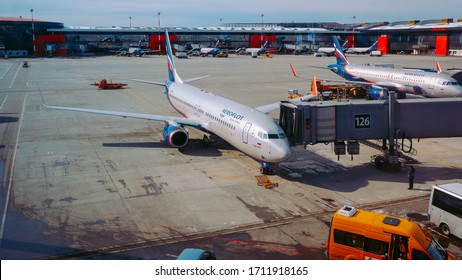 Moscow / Russia - March 16 2020: Boeing 737-800 Aeroflot at the gate of Sheremetyevo Airport, Terminal B. At the background ther planes of Aeroflot at the gates.