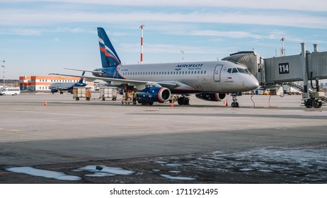 Moscow / Russia - March 16 2020: Sukhoi Superjet 100 Aeroflot at the gate of Sheremetyevo Airport, Terminal B.